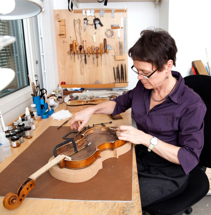 Luthier carrying out a conservation treatment. Photo credit: Hana Zushi Rhodes, Royal Academy of Music